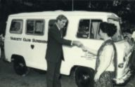 Puan Noor Aishah receiving keys to a van donated to the Singapore Association for Retarded Children by the Bourne British Army School