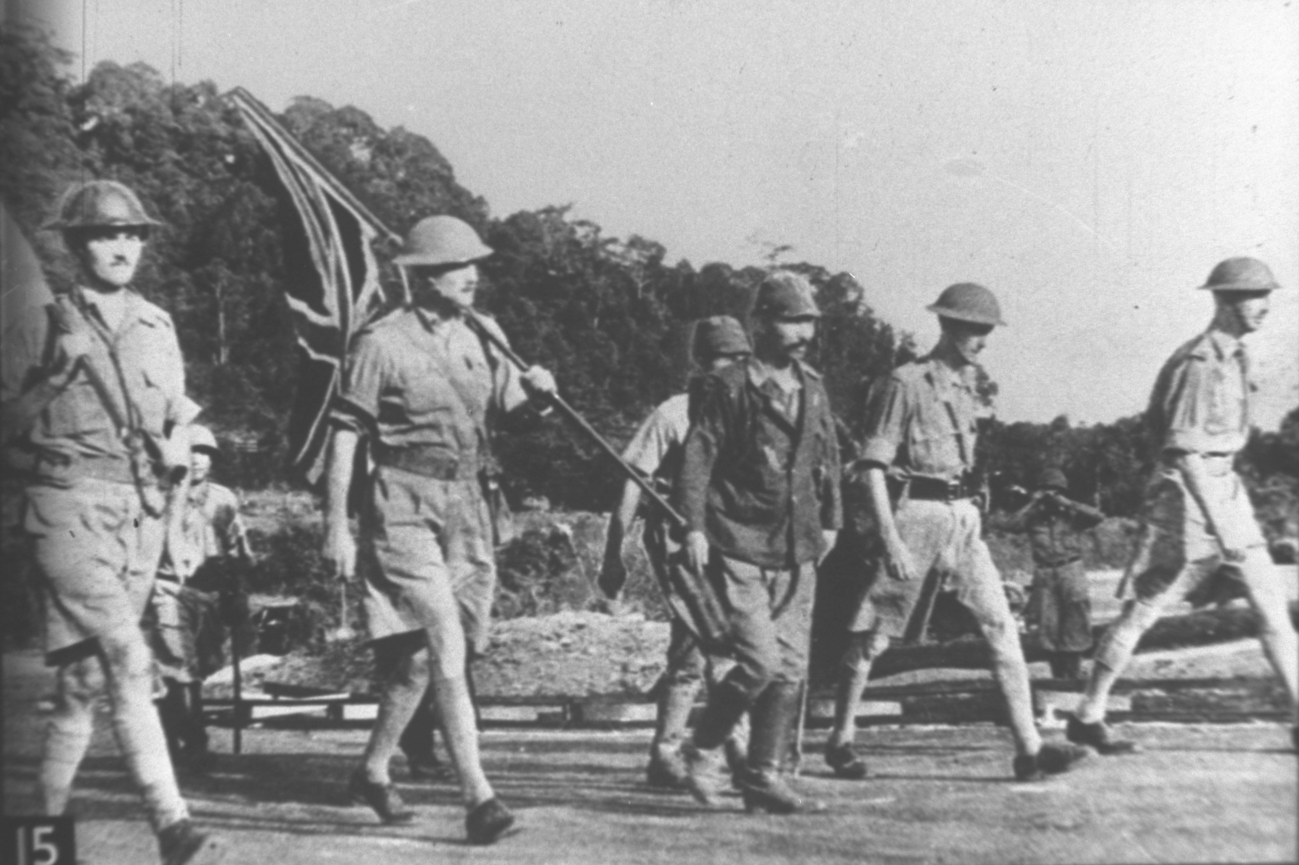 Lieutenant General Percival (right) and other British officers on the way to Ford Factory at Bukit Timah to surrender, marking the beginning of the Japanese Occupation of Singapore