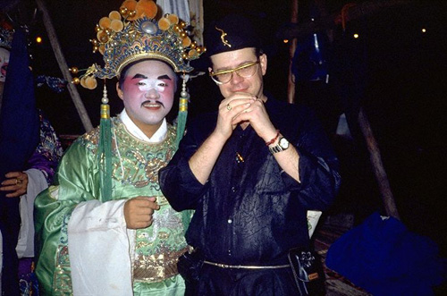 Tourist with chinese opera actor