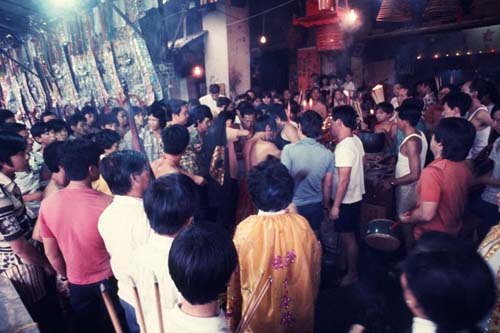 Crowd offering joss sticks at temple