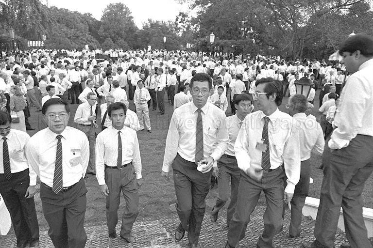 (From right, facing camera) Trade and Industry Minister and Second Minister for Defence Brigadier-General Lee Hsien Loong (second) and Chairman of Economic Development Board Philip Yeo (first) at cocktail party in Istana grounds