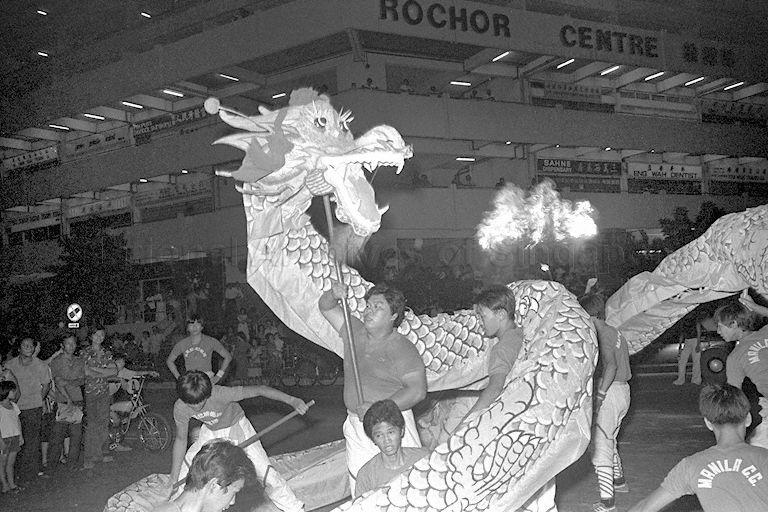 Dragon dance display at Rochore 1980 Exposition at Rochore Road opened by Minister for Health Dr Toh Chin Chye