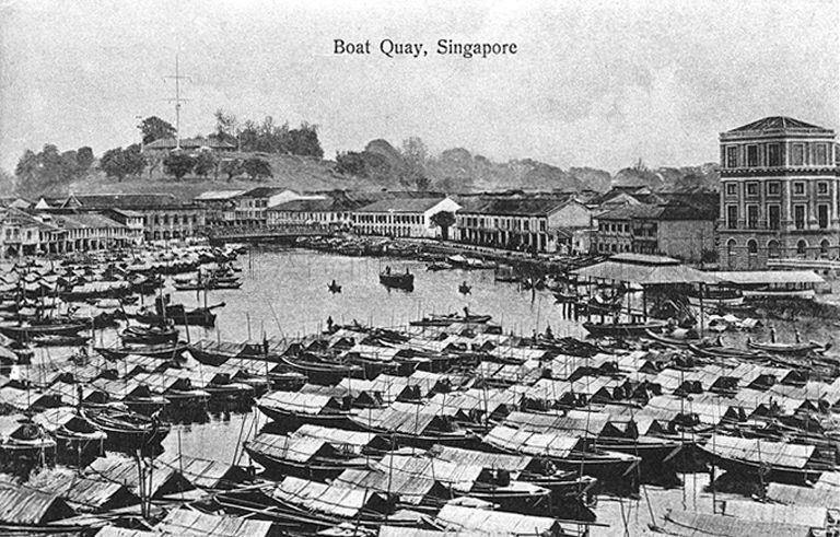 View of Boat Quay looking towards Fort Canning Hill, Singapore. The covered landing stage on the right was the site of the original Hallpike Boatyard where boat building and repairs were carried out from 1823 to late 1860s.