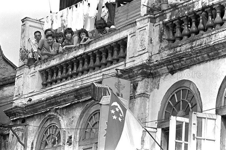 National Day Parade 1966 at the Padang - Proud Singaporeans in Chinatown watching the parading contingents from their balcony