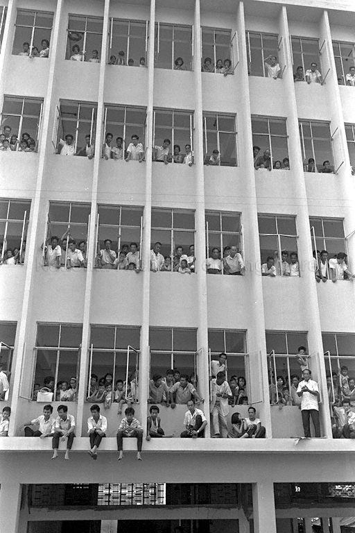 National Day Parade 1966 at the Padang - Spectators filling up a multi-storey building in Chinatown to view parade