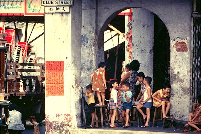 Children playing at five-foot-way of shophouses along junction of Club Street and Gemmill Lane
