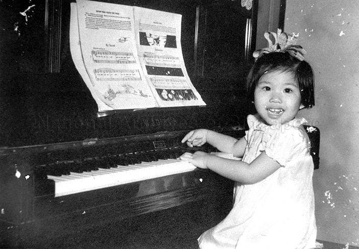 VIVIEN GOH, DAUGHTER OF GOH SOON TIOE PLAYING THE PIANO