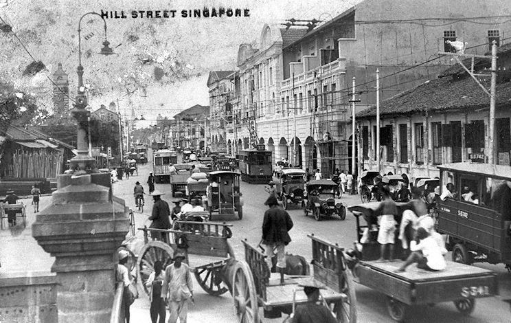 View of Hill Street from corner of Hill Street and River Valley Road (left, foreground). The tower of the Hill Street Fire Station erected in 1909 is visible down the street on the left.