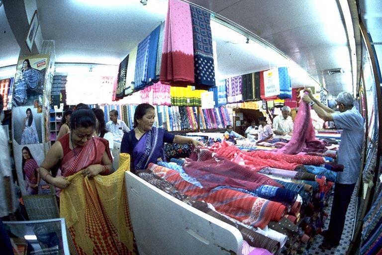 Ladies selecting cloth for saris during Deepavali shopping in Serangoon Road area