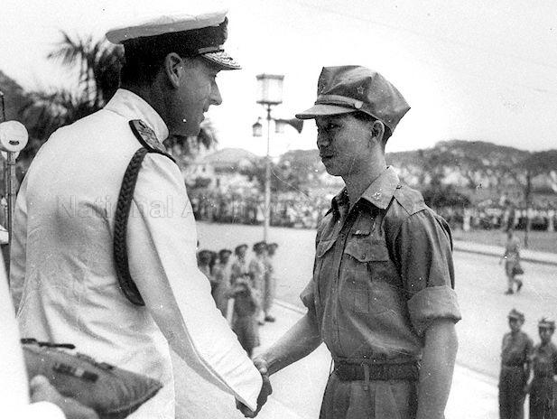 On the left is Lord Louis Mountbatten. On the right is Chin Peng, then member of the Malayan People's Anti-Japanese Army (MPAJA) and would later go on to be the Secretary-General of the Malayan Communist Party (MCP) or Communist Party of Malaya (CPM).