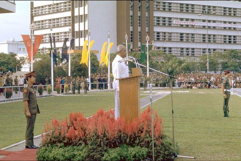 National Day Parade 1977 at Toa Payoh Stadium -- Minister for Foreign Affairs S Rajaratnam reviewing marchpast