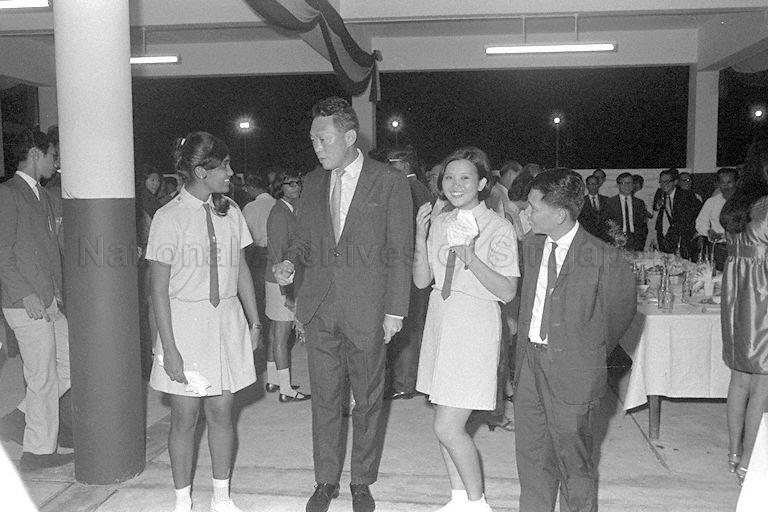 Prime Minister Lee Kuan Yew talking with students at official opening of National Junior College (NJC). On the right is NJC principal Lim Kim Woon.