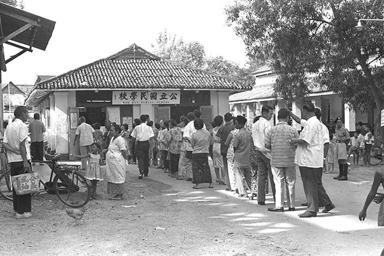 Queuing up to cast a vote on the options of merger during Singapore National Referendum Day 1962