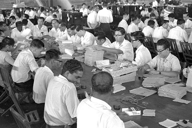 Counting of ballot papers of the Singapore National Referendum 1962 at Singapore Badminton Stadium counting centre