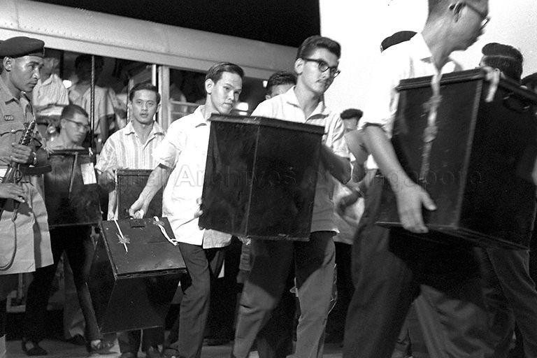 Ballot boxes arriving at Singapore Badminton Stadium counting centre during the Singapore National Referendum on Singapore-Malaya merger