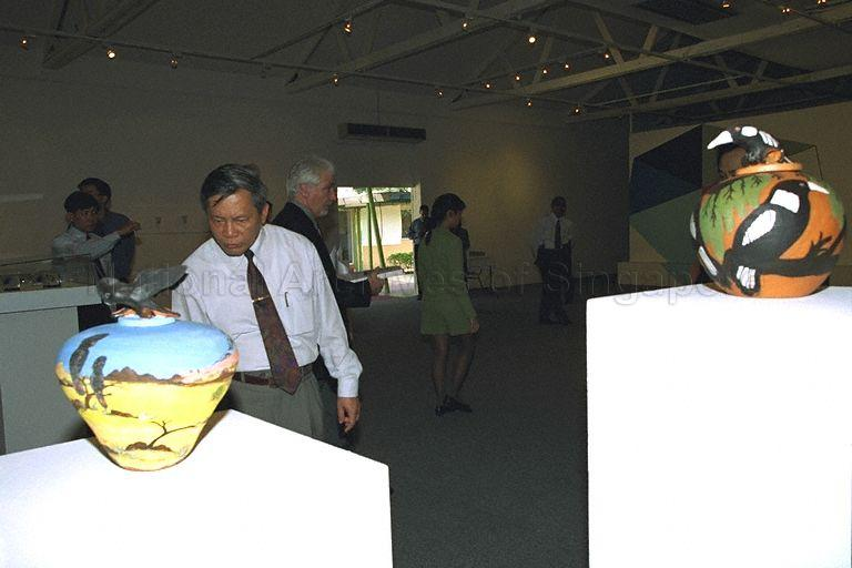 Vietnam's Minister for Culture and Information Nguyen Khoa Diem, who is on a four-day visit to Singapore from April 7 to 10, viewing exhibits during tour of LASALLE-SIA College of the Arts at 90 Goodman Road