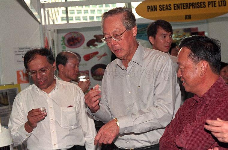 Prime Minister Goh Chok Tong sampling a drink when he tours …