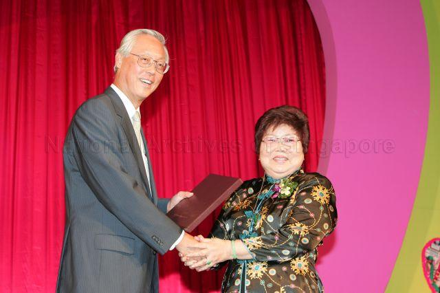 Senior Minister Goh Chok Tong presenting the book 'Tribute to Goh Chok Tong, Prime Minister of Singapore, 1990-2004' during Marine Parade charity dinner at Raffles City Convention Centre