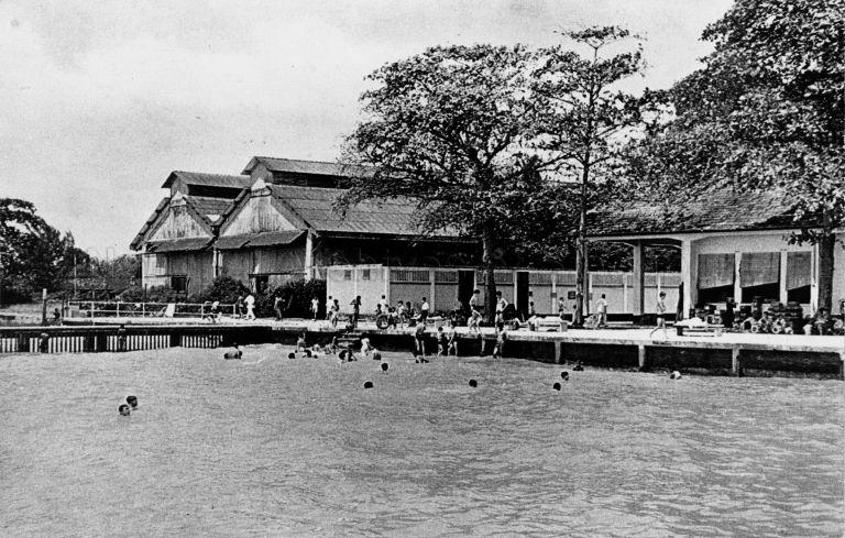 Katong Park bathing pagar, Singapore's first public sea swimming enclosure. It was opened on 19 December 1931 by W Bartley, President of the Municipal Commissioners. At 50 yards (about 45 metres) in length, extending 100 feet (about 30 metres) into the sea, it had 40 dressing rooms (white block with ventilation grooves in centre of photo). The place was closed in the 1960s when the coast was reclaimed.