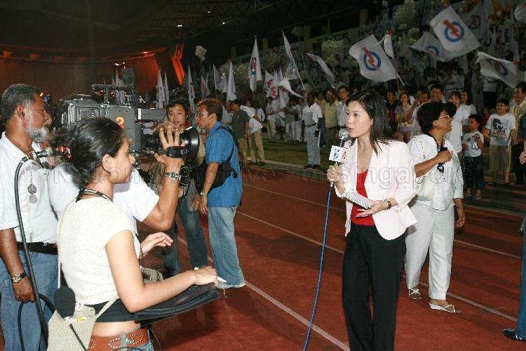 Channel NewsAsia newscaster Ms Sharon Tong reporting during …