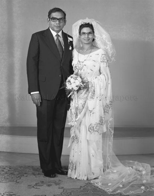 Full length portrait of bride and groom