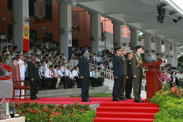 Chief of Defence Force Lieutenant General Desmond Kuek leading Singapore Armed Forces (SAF) personnel in reciting the SAF pledge to reaffirm their loyalty to the nation and their commitment to the defence of Singapore during SAF Day parade at SAFTI Military Institute. On the left is President S R Nathan.