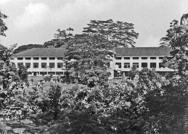 Fort Canning Barracks,the headquarters of the British Armed Forces in Singapore, with cemetery in front, c.1950s