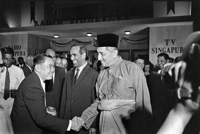 Opening of regular television service at Radio Television Singapura - Yang di-Pertuan Negara Yusof Ishak shaking hands with guests, accompanied by Minister for Culture S. Rajaratnam