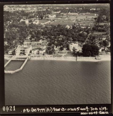 Aerial view of Joo Chiat with Chinese Swimming Club visible, identifiable by its enclosed swimming pool jutting out into the sea