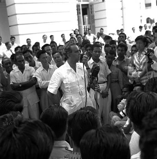 Chief Minister David Marshall of the Labour Front Party speaking to a crowd of supporters at Empress Place